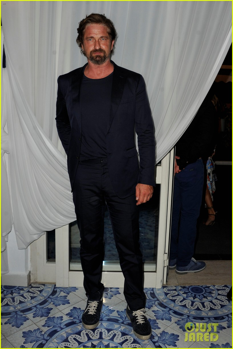 gerard butler suits up in ischia rides scooter around town 01