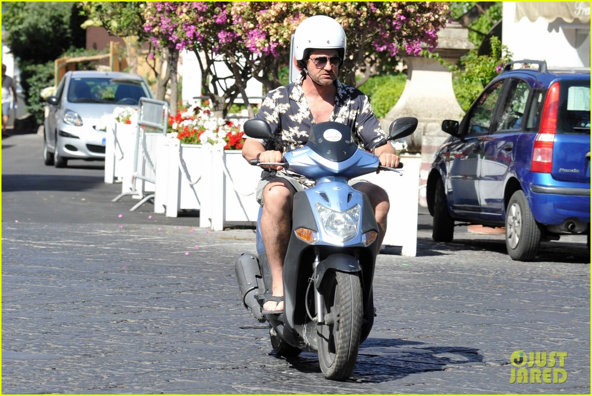 gerard butler suits up in ischia rides scooter around town 033926384