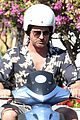 gerard butler suits up in ischia rides scooter around town 02