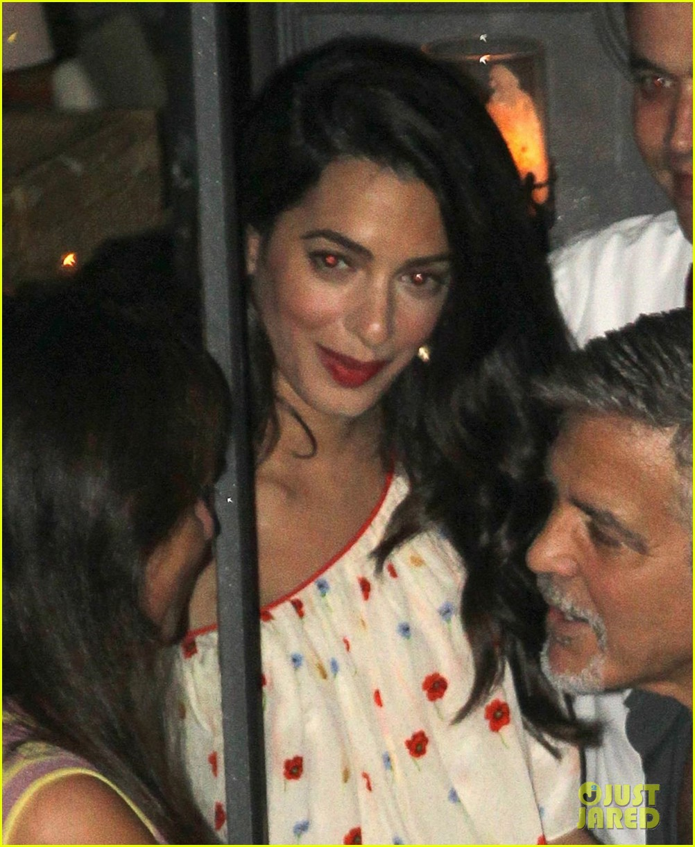 new parents george amal clooney dine with friends in italy 02