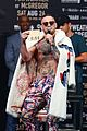 conor mcgregor goes shirtless during press conference with floyd mayweather jr 30
