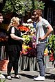 liam hemsworth has a flower for rebel wilson on isnt it romantic set 10