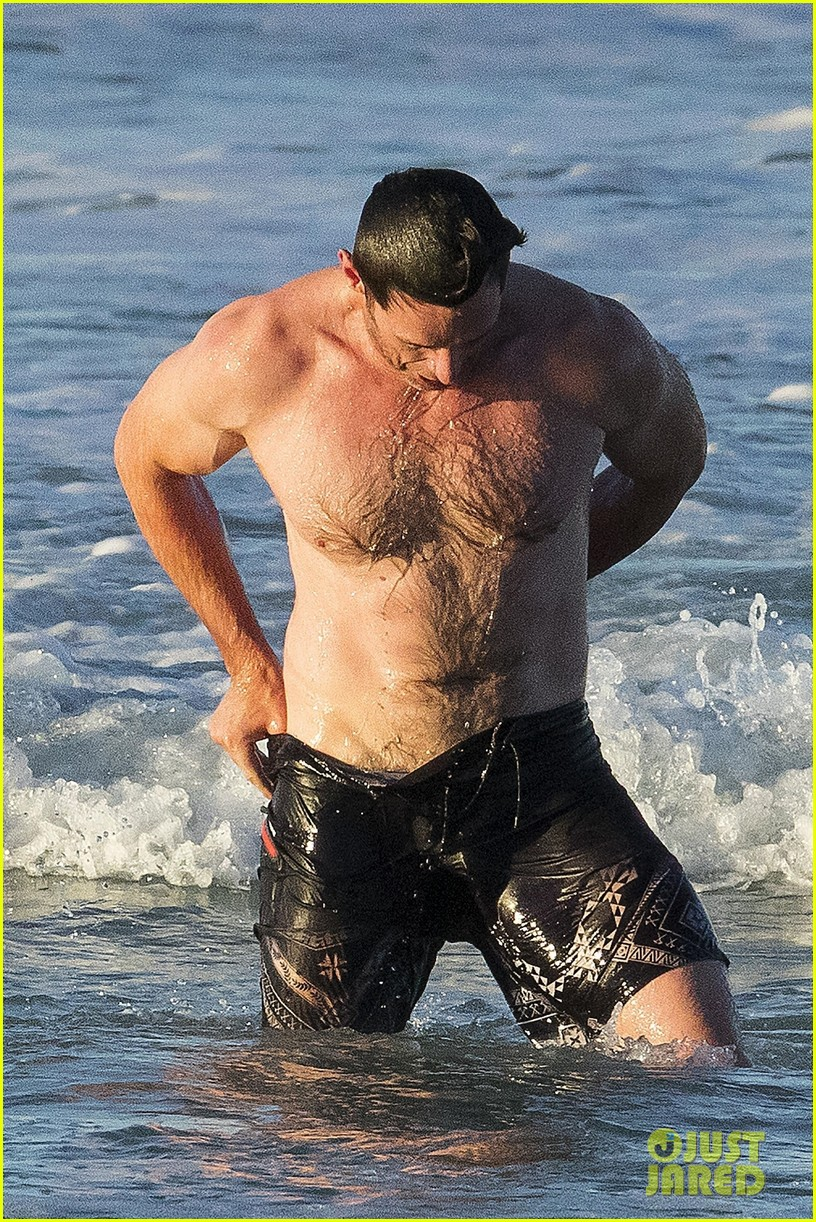 hugh jackman hits the beach with his speedo clad trainer 023935319