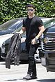 nick jonas shows off his buff biceps in a tight t shirt 08