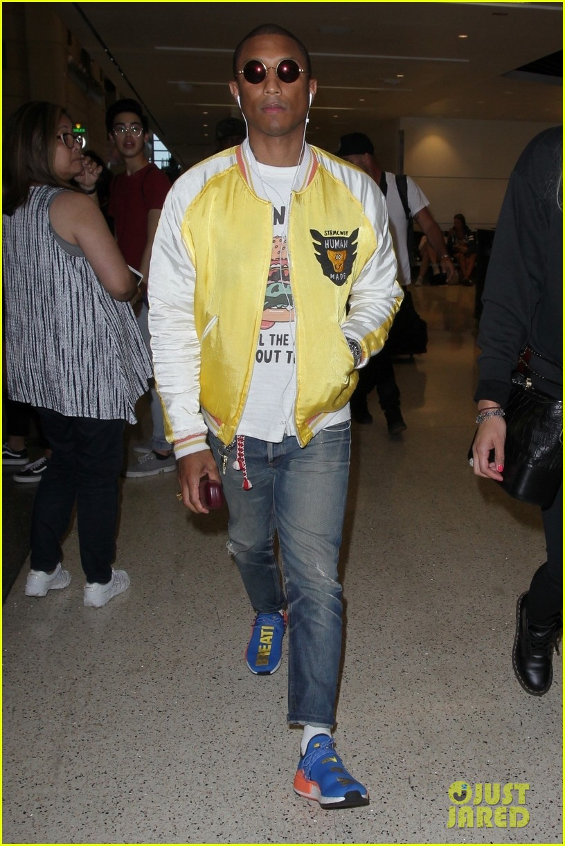 pharrell williams and wife helen lasichanh step out during paris fashion week 013923656