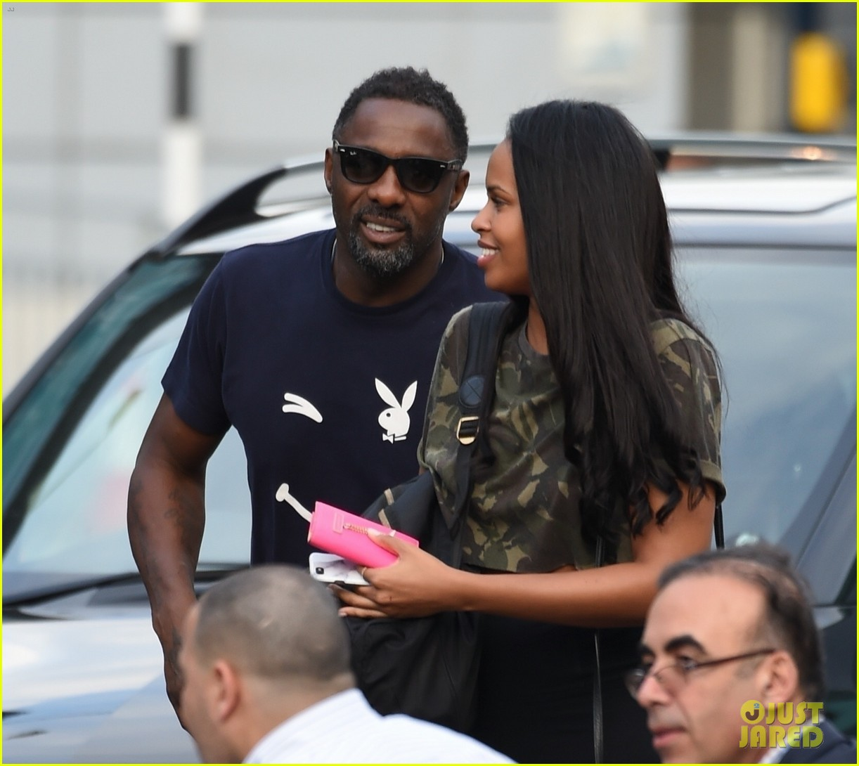 idris elba steps out with mystery woman at manchester airport 013947735