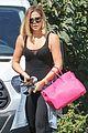 khloe kardashian flaunts her toned abs in black bodysuit 02