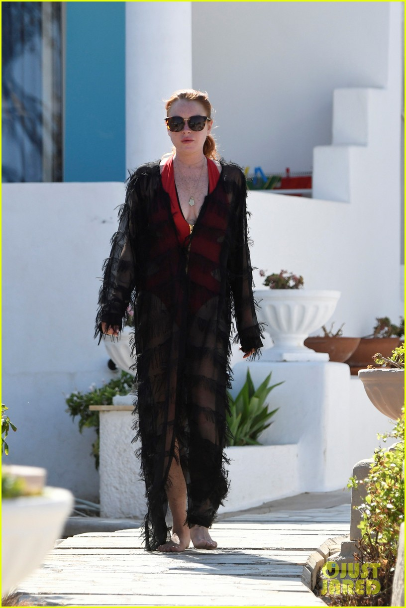 lindsay lohan sports red one piece in greece 013947587
