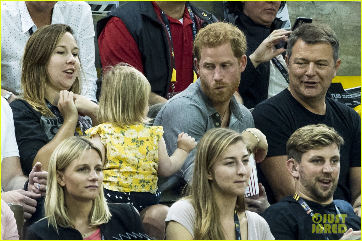 prince harry makes funny faces for a baby at the invictus games 023965507