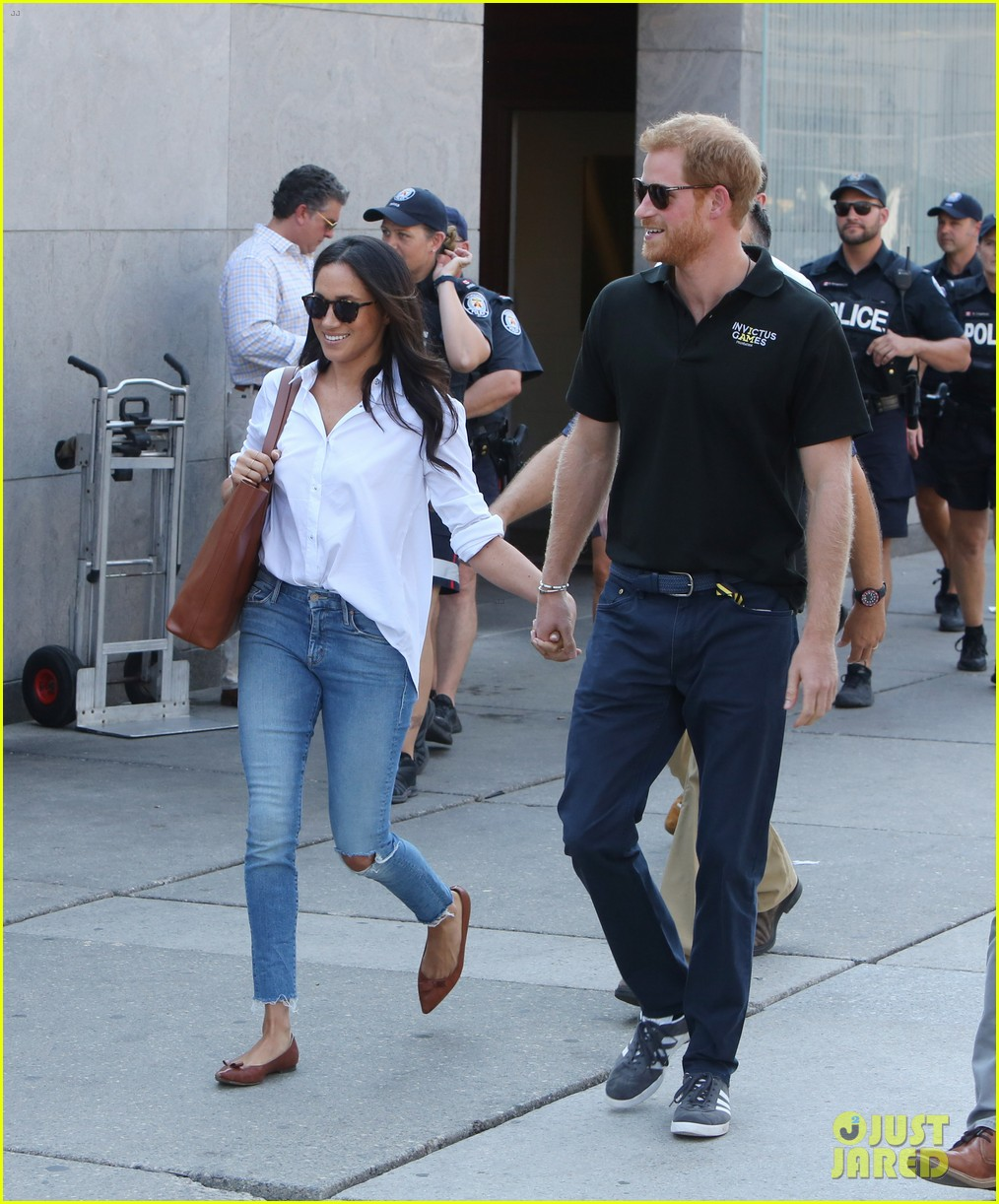 Prince Harry & Meghan Markle Hold Hands, Make First Public