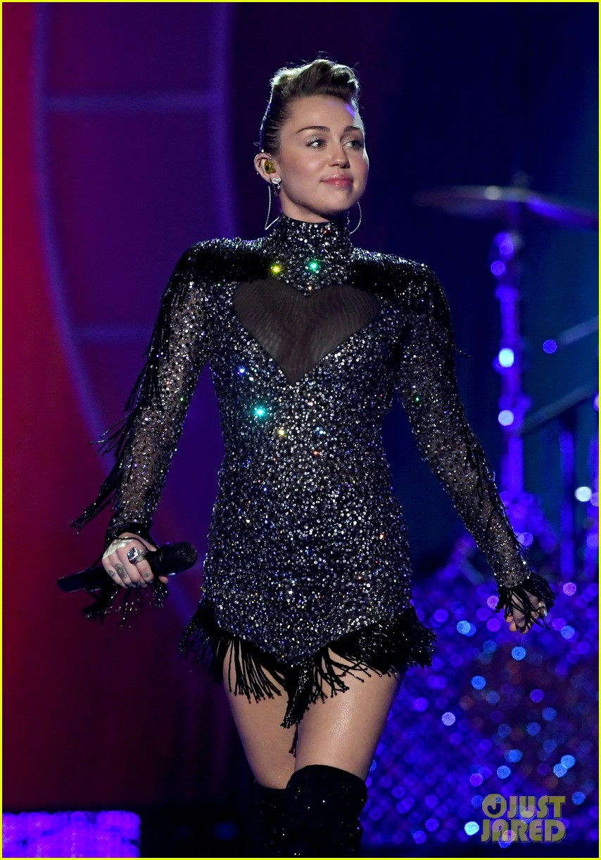 miley cyrus sparkles on stage at iheartradio music festival. 283963219