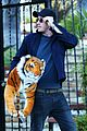 garrett hedlund carries giant stuffed tiger around the neighborhood 20