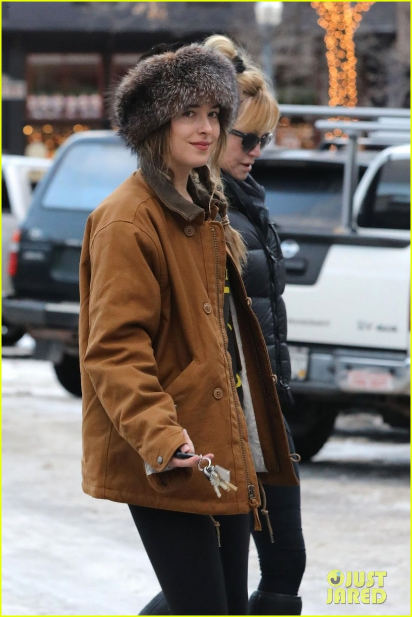 dakota johnson mom melanie griffith hold hands in aspen 024004912
