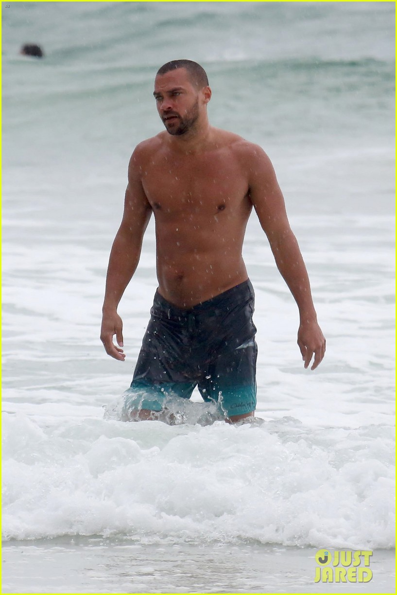 shirtless jesse williams shows off his abs on the beach 03