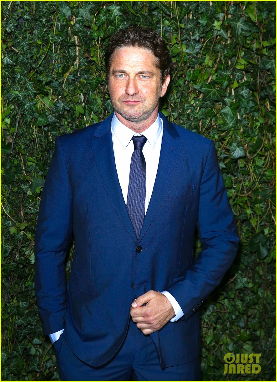 gerard butler suits up for chanel pre bafta party 06