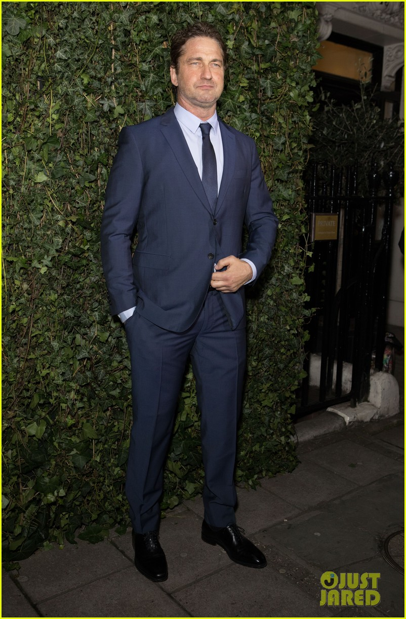 gerard butler suits up for chanel pre bafta party 09