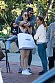 emmy rossum rocks denim dress with white t shirt for shopping trip 02