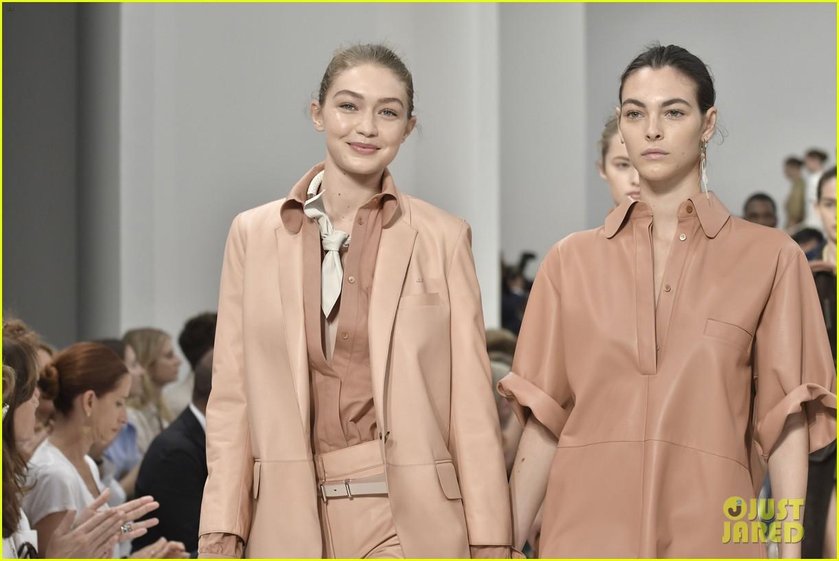 gigi and bella hadid strut their stuff in tods milan fashion week show2 12