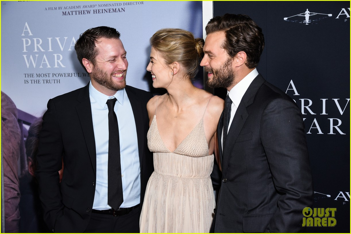 jamie dornan rosamund pike step out for a private war los angeles premiere 05