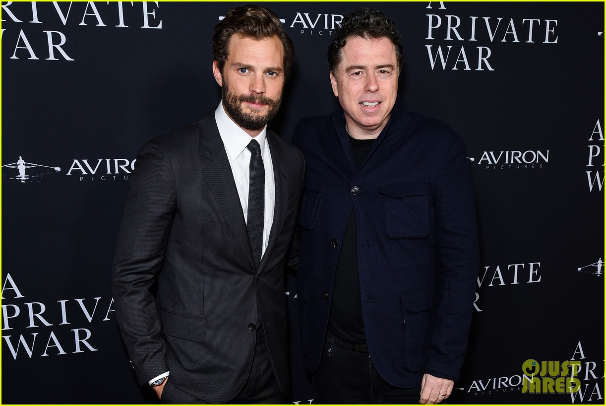 jamie dornan rosamund pike step out for a private war los angeles premiere 07