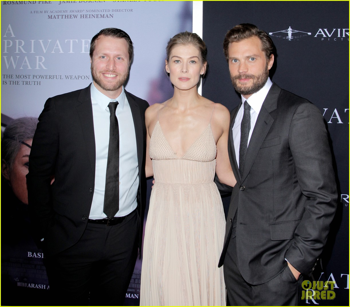 jamie dornan rosamund pike step out for a private war los angeles premiere 16
