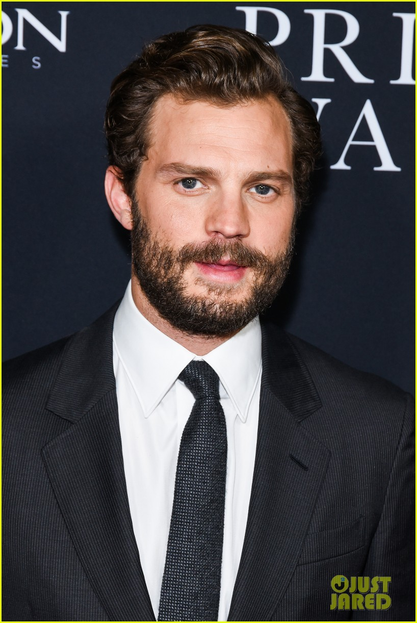 jamie dornan rosamund pike step out for a private war los angeles premiere 23