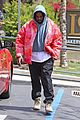 kanye west rocks tie dye while leaving the office 02