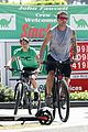 ryan phillippe bares his tattooed muscles on bike ride 03
