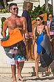 simon cowell fit physique on the beach with lauren silverman 01