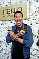 lionel richie supported by girlfriend lisa parigi at hello fragrance launch 03