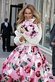 Photo 4 of Celine Dion Throws A Bouquet of Roses To Fans in NYC