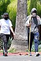 chadwick boseman walks with a walking stick 14
