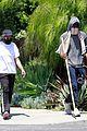 chadwick boseman walks with a walking stick 22