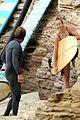 gerard butler surfing wetsuit 34