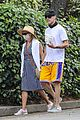 reese witherspoon jim toth hold hands on afternoon walk 03