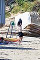 aaron taylor johnson shirtless changing wetsuit beach day surf 17