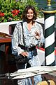 taylor hill matches mask to dress venice film festival 01
