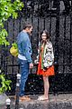 lily collins caught in rain with lucas bravo emily in paris 13