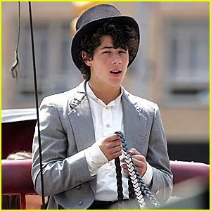 Nick Jonas Horses Around in a Top Hat