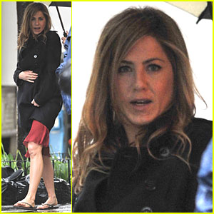 Jennifer Aniston hurries through the rain in her flip-flops on the set of ...