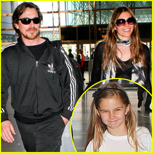 Christian Bale & Family Take Flight