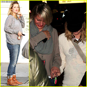 Drew Barrymore and pal Cameron Diaz hold hands as they leave the Coldplay ...