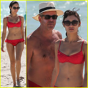 Olga Kurylenko: Bikini Beach Babe with Beau Danny Huston!