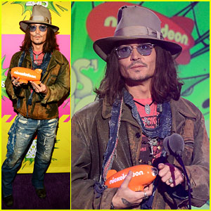 holds his blimp trophy on stage at the 2013 Kids' Choice Awards