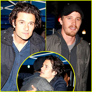 Orlando Bloom & Garrett Hedlund Hug It Out at Pre-Oscars Party