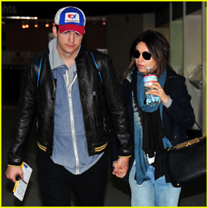 Pregnant Mila Kunis & Ashton Kutcher Fly to His Hometown!