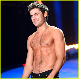 Zac Efron Goes Shirtless After Winning MTV Movie Award!