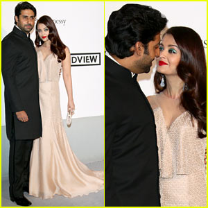 Aishwarya Rai & Husband Abishek Bachchan Share Sweet Glance at Cannes amfAR Gala 2014