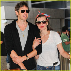 Milla Jovovich & Husband Paul W.S. Anderson Look So in Love at LAX