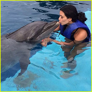 Kim Kardashian Swims with the Dolphins, Gives One a Kiss (Video)